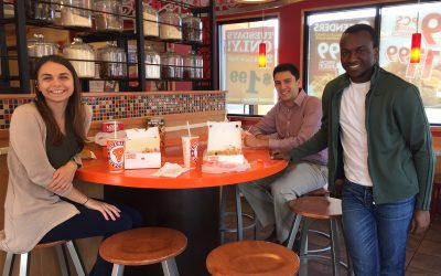From left: Roma Romaniv, Joaquin Sanchez and Stephen Mwangi—the team of undergraduate finance students who took place in the Cornell Stock Pitch Challenge—pictured at a Popeyes Restaurant. (UConn School of Business)